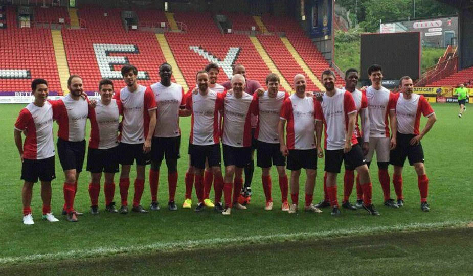 Healthy workplace football team match